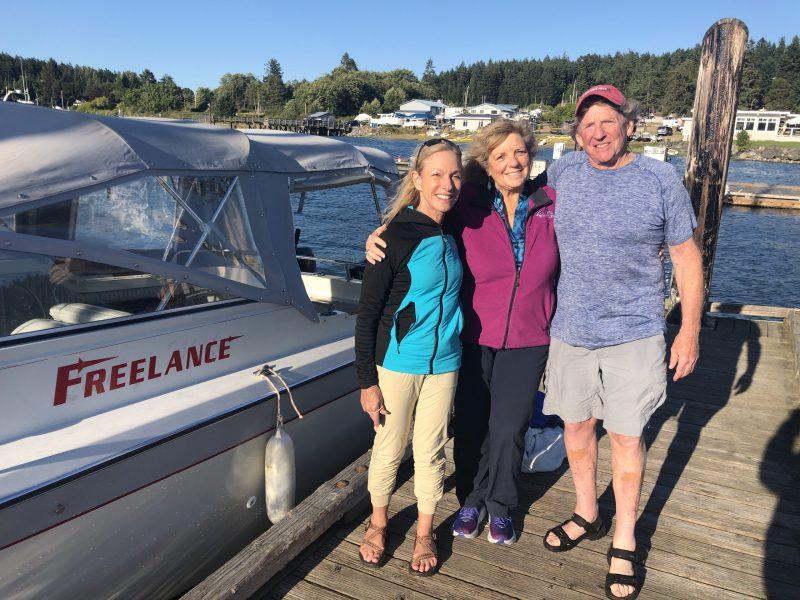 Risa Wyatt, Carrie Wilson and Peter Schroeder meet in a surprising encounter on a boat dock in the San Juan Islands