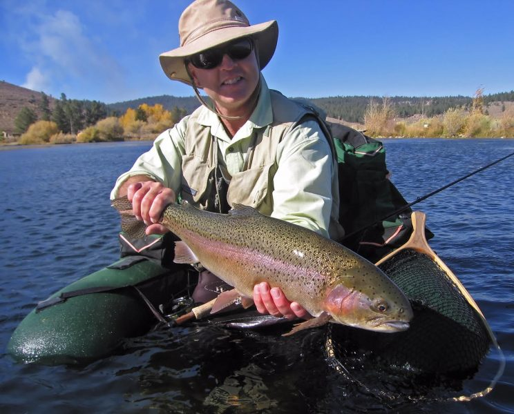"""The author with an """"average size"""" trout from Alpers' Pond in 2006.  Photo by Bill Beecher."""